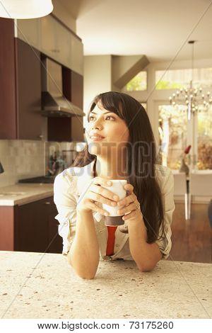 Hispanic woman drinking tea