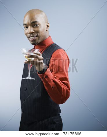 African American man holding cocktail