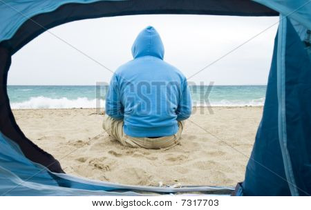Man sitting in front of tent