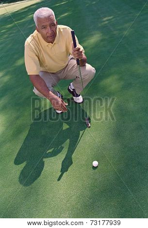 Senior African American man on golf course
