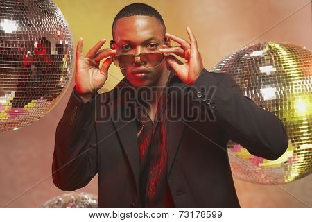 African American man putting on sunglasses