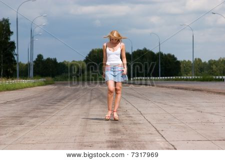 Active Young Woman Goes On A Highway.