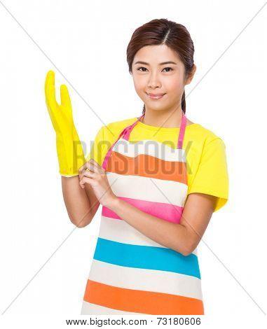 Housewife wear plastic gloves