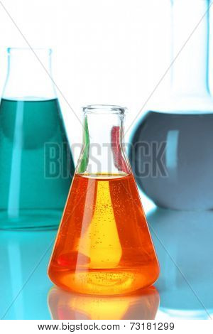 Test tubes with colorful liquids close up