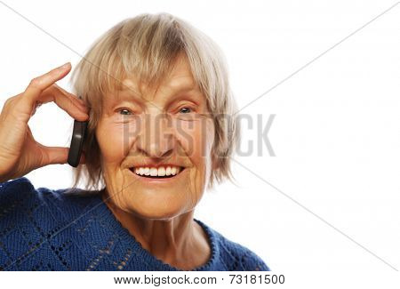 Smiling old lady communicating through mobile phone