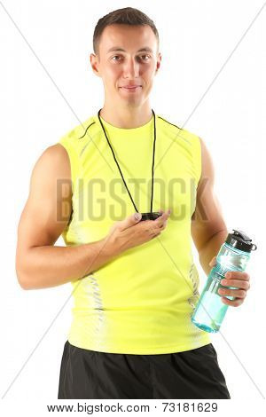Handsome young sportsman holding bottle with water and stopwatch isolated on white