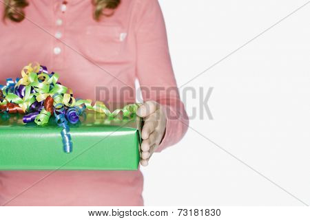 Hispanic girl holding gift