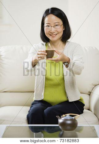 Asian woman drinking tea