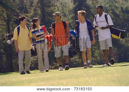 Multi-ethnic friends on golf course