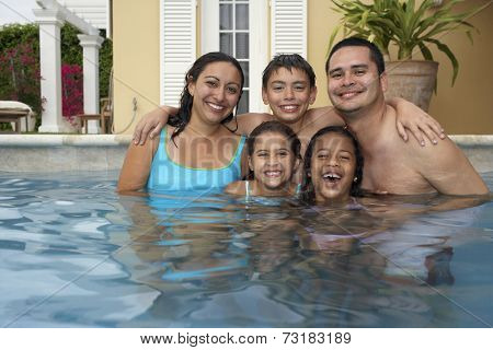 Multi-ethnic family in swimming pool