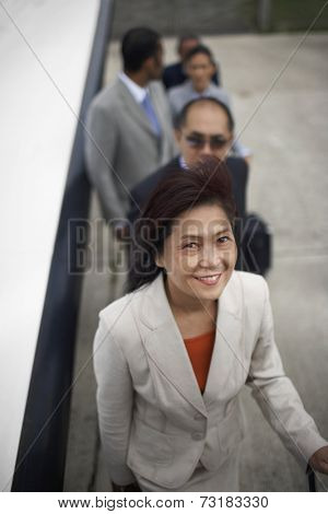 Asian businesswoman waiting on line