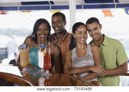 Multi-ethnic couples at bar