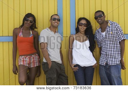 Multi-ethnic friends wearing sunglasses