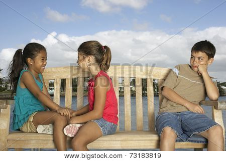 Mixed Race children on bench