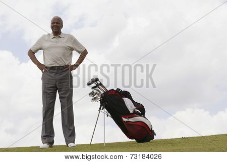Senior African American man next to golf bag