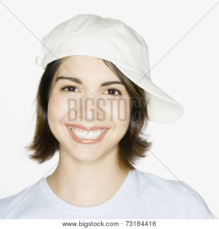 Mixed Race woman wearing sideways painter's hat