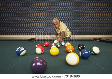Senior Mixed Race man playing pool
