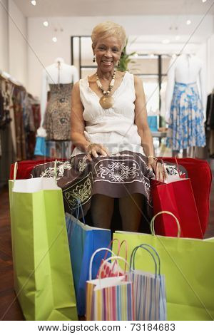 Senior African American woman clothes shopping