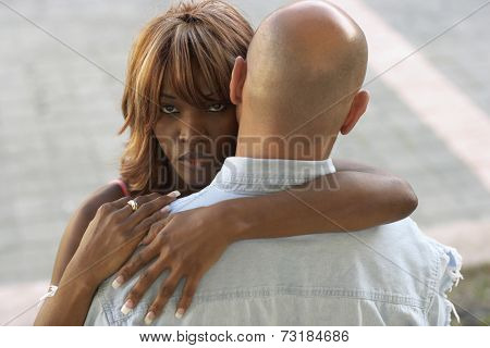 Close up of multi-ethnic couple hugging