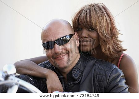 Multi-ethnic couple on motorcycle