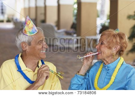 Senior couple at birthday party