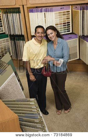 Multi-ethnic couple in flooring store