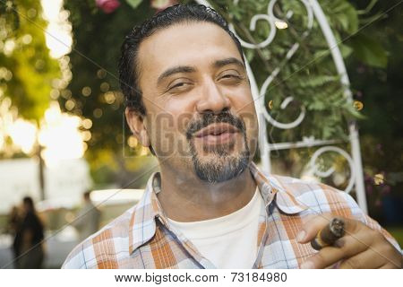 Hispanic man smoking cigar