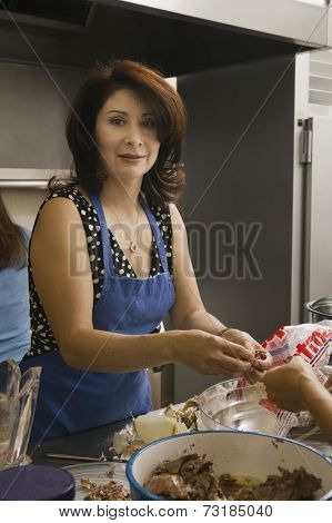 Hispanic woman preparing food