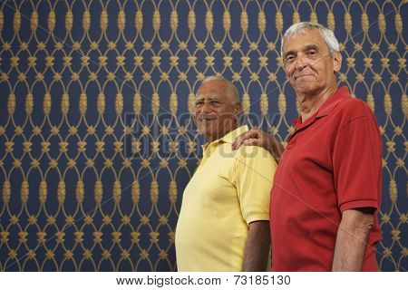Senior man with hand on friend's shoulder