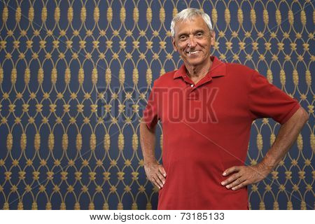 Senior man with hands on hips