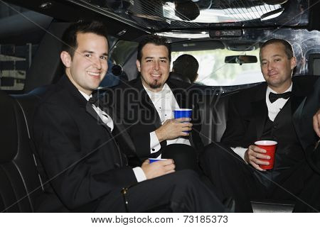 Multi-ethnic men in tuxedos