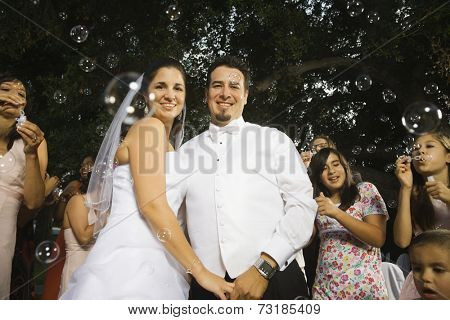 Hispanic newlyweds hugging