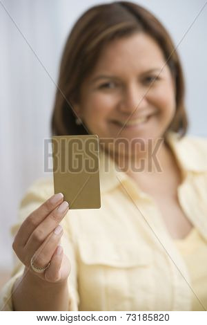 Hispanic woman holding up card