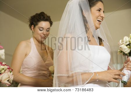 Hispanic bride laughing