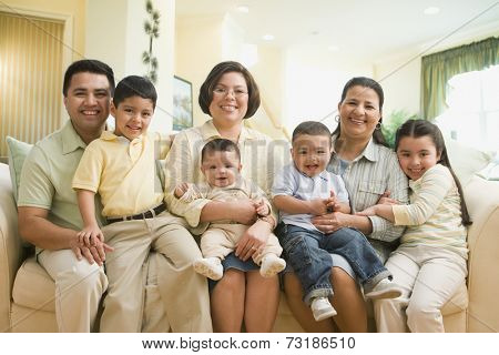 Multi-ethnic family on sofa