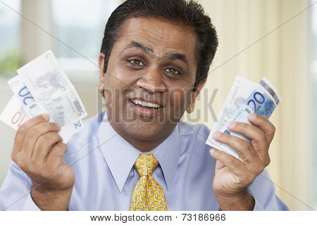 Middle Eastern man holding money