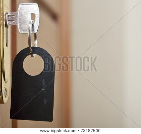 key in keyhole with blank label