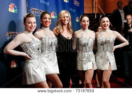 NEW YORK-SEP 17: Model Heidi Klum (C) poses with the Rockettes at the post-show red carpet of America's Got Talent: The Finale Season 9 at Radio City Music Hall on September 17, 2014 in New York City.