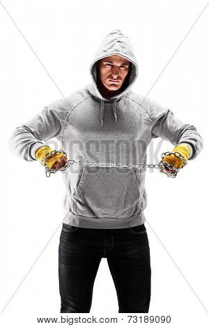 Vertical shot of a hooligan holding a chain isolated on white background