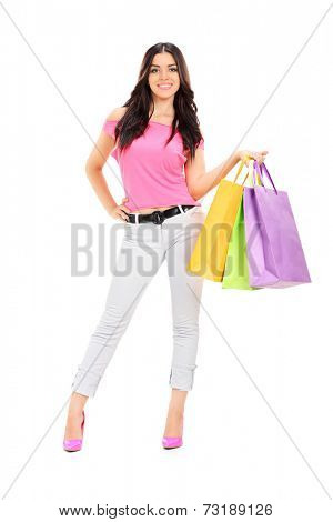 Full length portrait of a woman posing with shopping bags isolated on white background