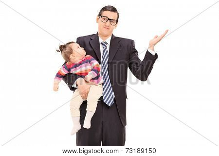 Carefree businessman holding his daughter and gesturing with his hand isolated on white background