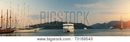 Panorama of the Marmaris bay with sail boats and daily cruise ships. Turkey