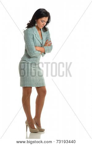 Young businesswoman thinking with arms crossed isolated over white background