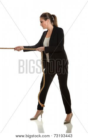 Businesswoman pulling rope isolated over white background