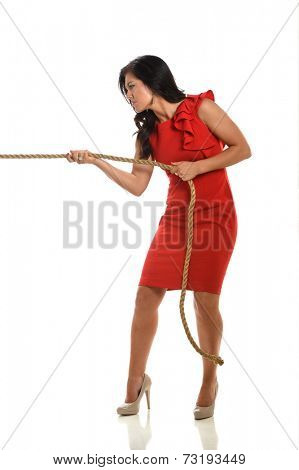 Young businesswoman pulling rope isolated over white background