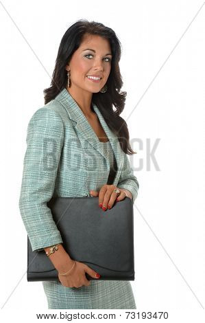 Attractive businesswoman holding binder isolated over white background