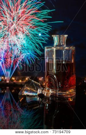 bottle of whiskey on a background of fireworks