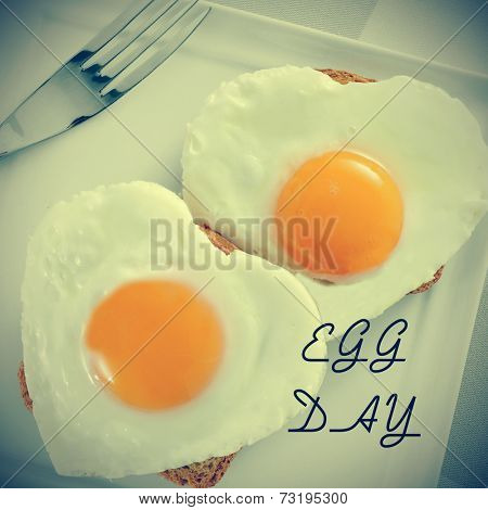 a pair of heart-shaped fried eggs on bread and the text egg day, for the world egg day, with a retro effect