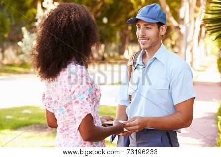 Mailman Delivering Letters To Woman