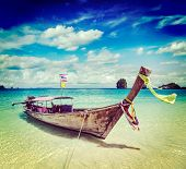 picture of long beach  - Vintage retro effect filtered hipster style travel image of long tail boat on tropical beach - JPG